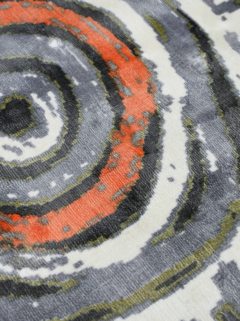 Akarley by Charmaine Pwerle - Indigenours rug design in orange, green and grey colours - cole up detail