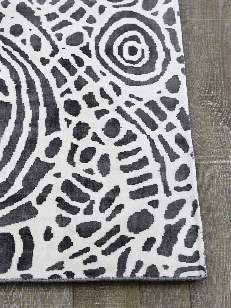 Kwerralya by Charmaine Pwerle - Indigenours rug design with black and white pattern - corner image